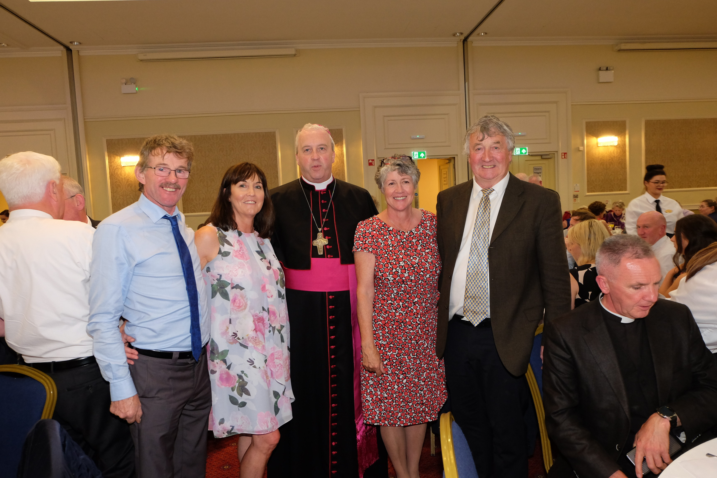John Joe and Mary Hussey, left, and Bridie and Dermot Dolan with the new Bishop Michael Router at a celebration dinner following the Bishop's Ordination