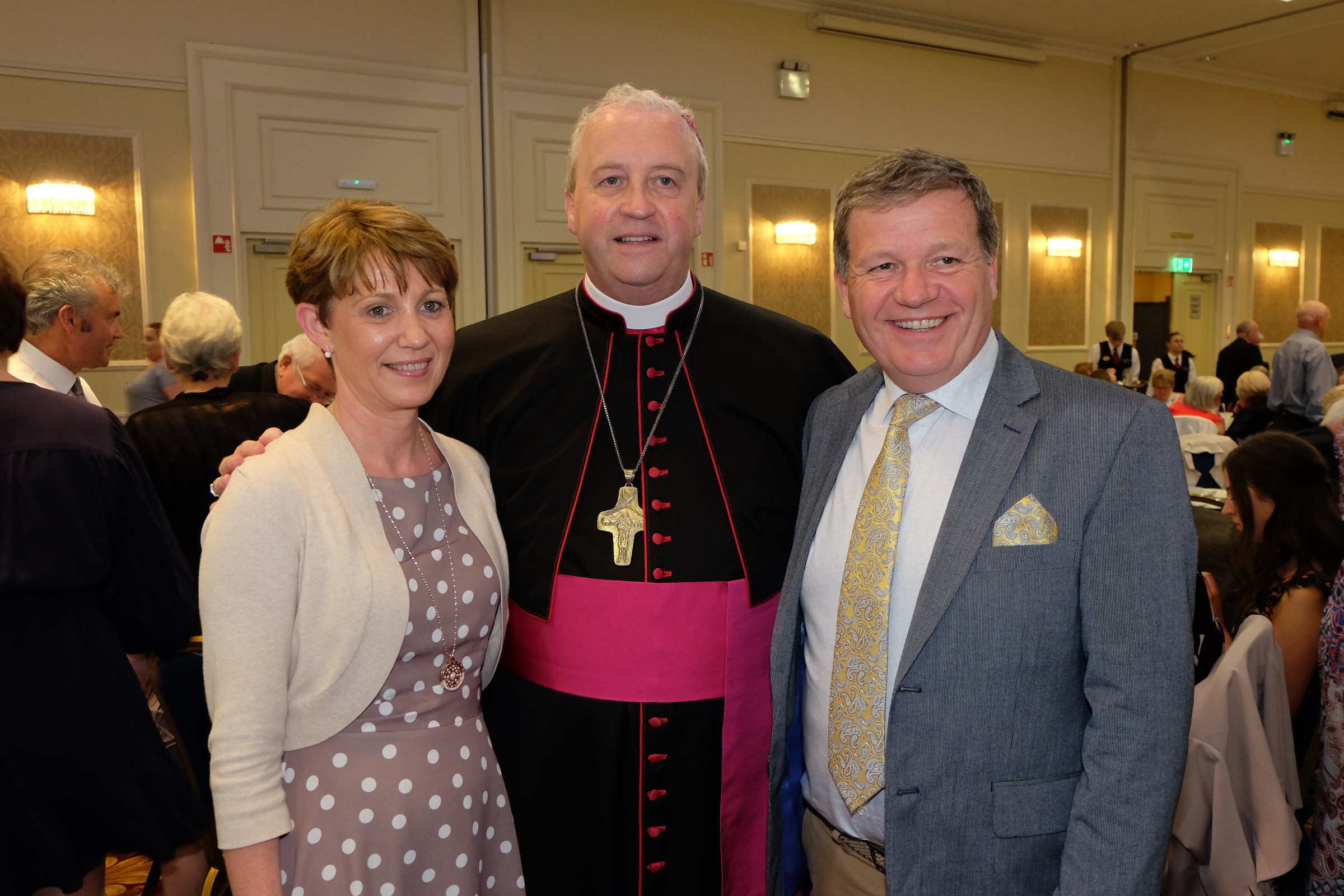 Siobhan and Patrick Farrelly with the new Bishop Michael Router at a celebration dinner following the Bishop's Ordination
