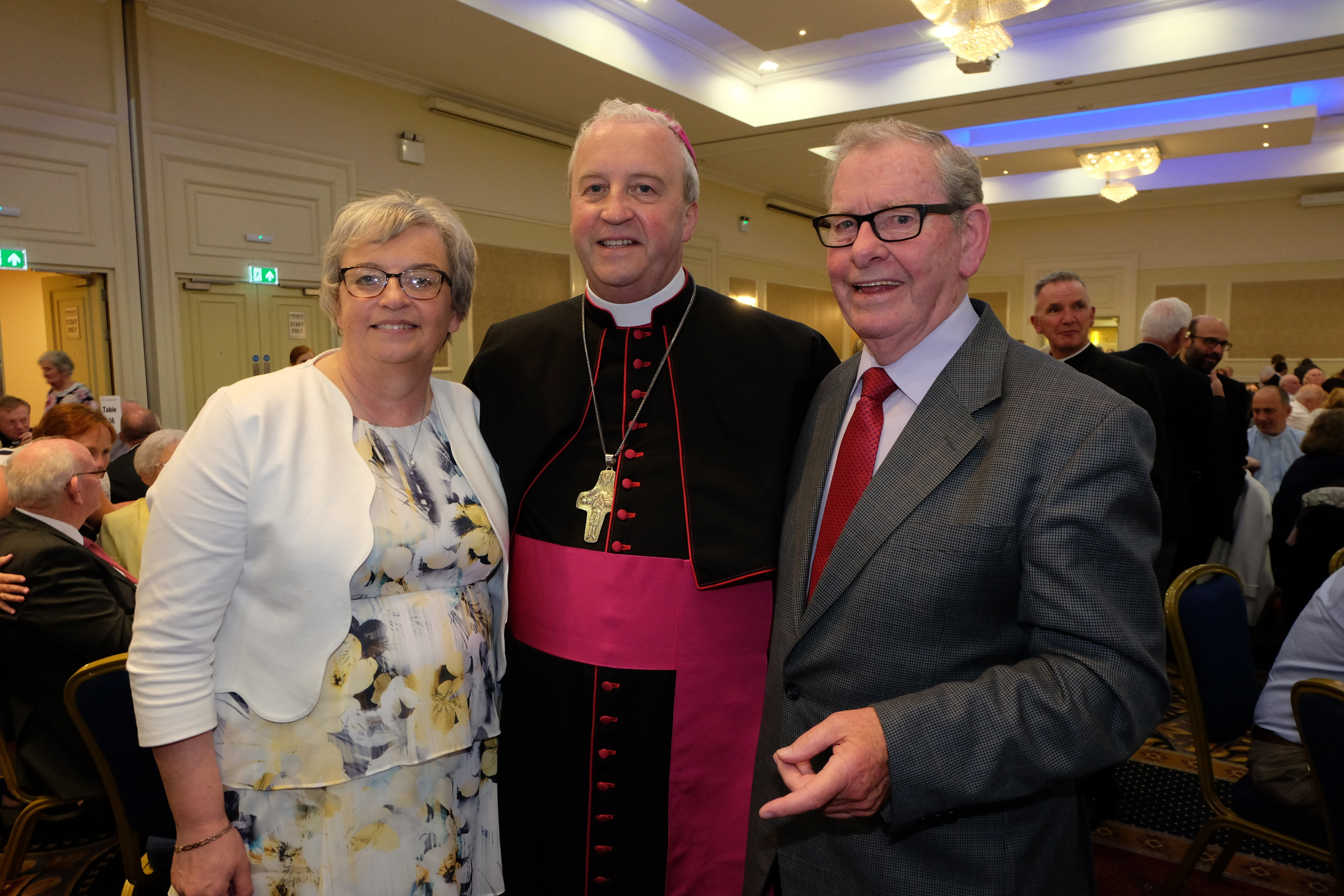 The new Bishop Michael Router, with his sister Breda Murphy, and his godfather Michael Murphy, at a celebration dinner following the Bishop's Ordination