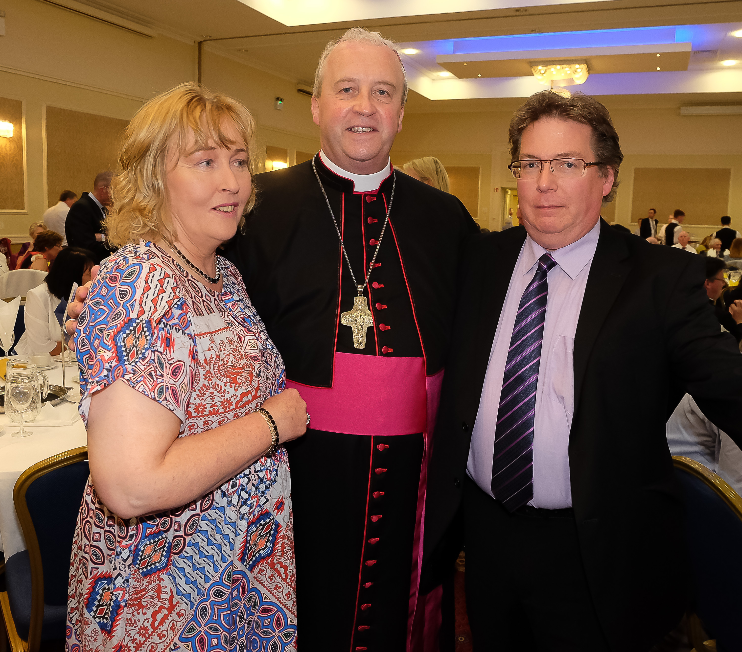 Geraldine and Alexis Sheridan with the new Bishop Michael Router at a celebration dinner following the Bishop's Ordination