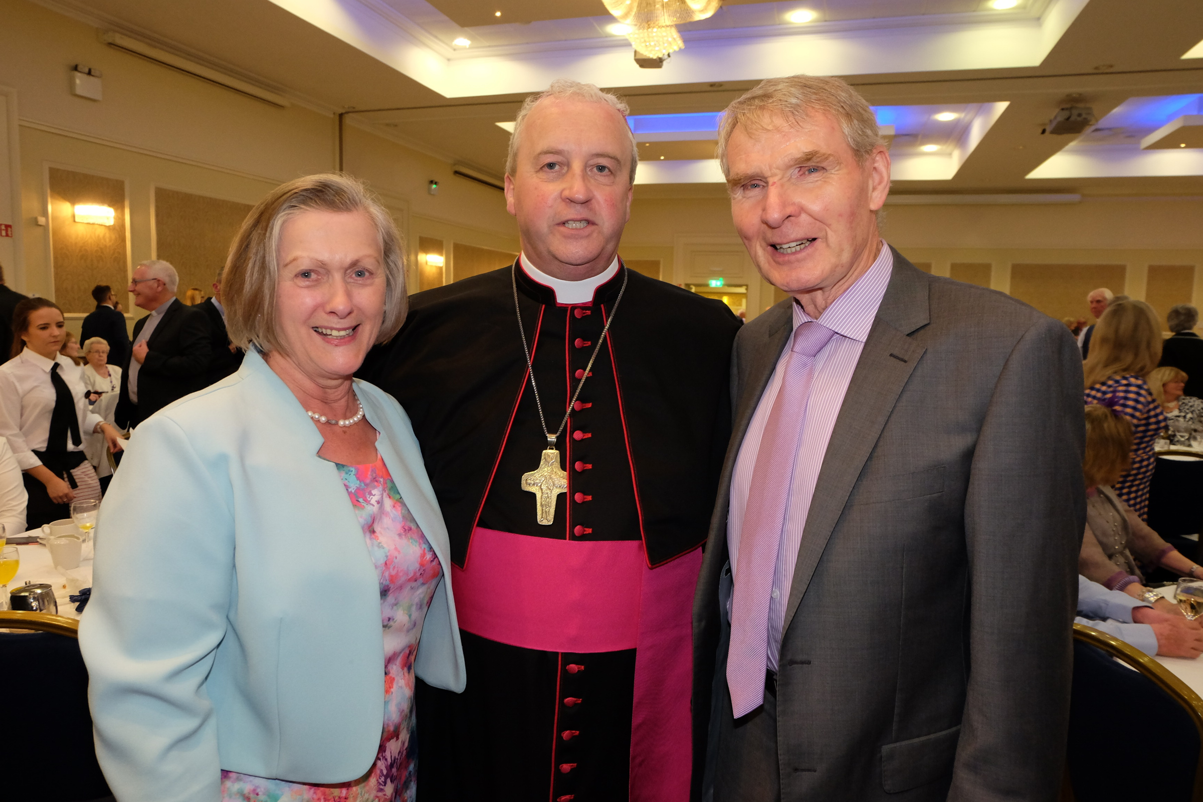 Tom and Kathleen McCreesh with the new Bishop Michael Router at a celebration dinner following the Bishop's Ordination