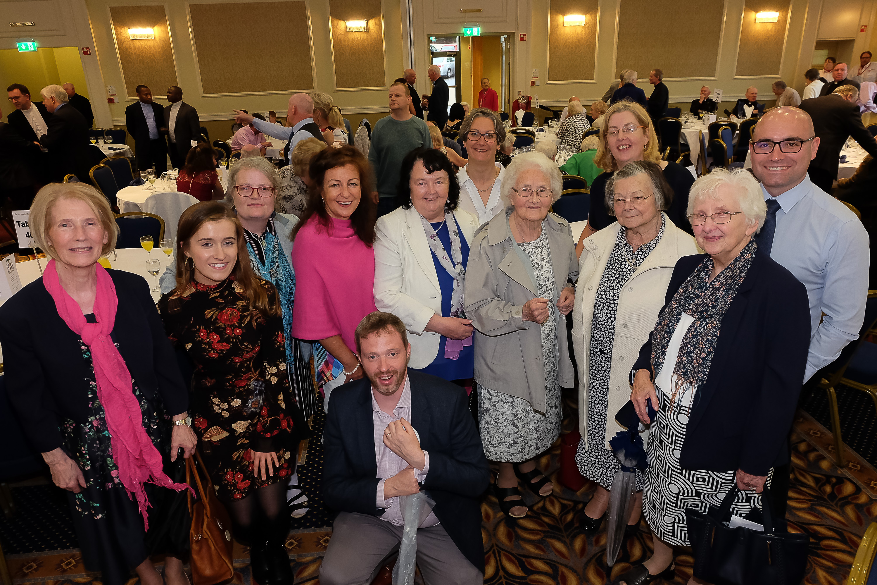 with the new Bishop Michael Router at a celebration dinner following the Bishop's Ordination