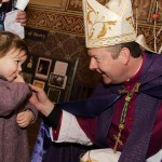 Archbishop Eamon Martin has a word with three year old Aibheann Divilly 